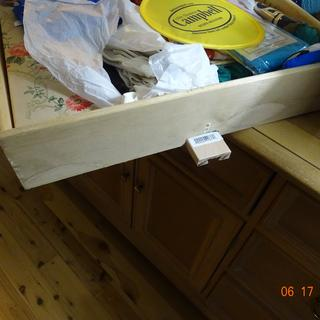 Rear of drawer with upper section of the slide extending beyond the drawer