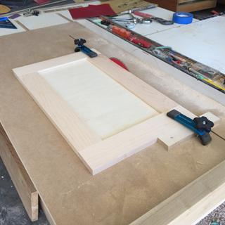 Fast and accurate cabinet door trim jig.