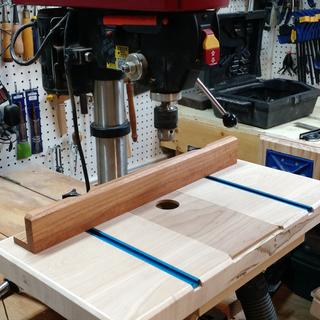 Drill Press Table with removable inserts, adjustable fence and dust collection.
