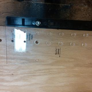 The holes were drilled with cabinet sides flat on the Bench.