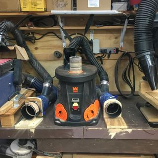 Elbow connector allows for two Sanders and a drill press in tight location