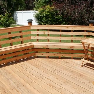 Octagon redwood deck using 25 bench brackets. 20 inches high from yard.