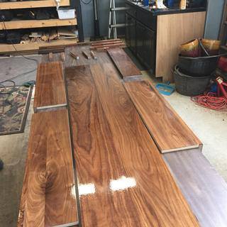 Wood being coated...the more coats you add the deeper it looks. The original isn't this glossy.