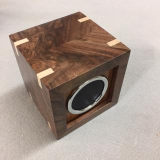 Walnut burl wood with maple accents.