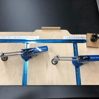 Cloud lift router template using auto-lock t-track hold downs