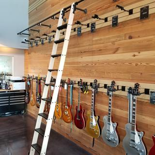 Barnett Music Exchange in Tulsa needed a way to reach the 3rd row of guitars.