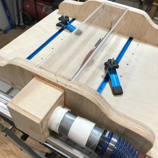 Table Saw sled with T-tracks and clamps.