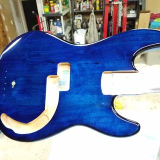 Light blue to darker blue to back burst on guitar.