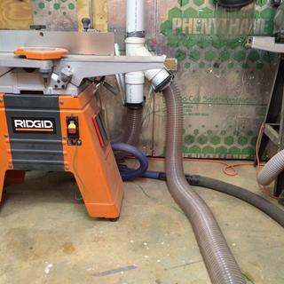 "Hoses going from jointer and table saw thru blast gates to 4"" PVC to Delta dust collector system"