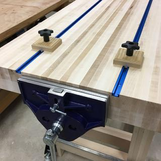 T-Tracks set into dadoes that run the length of the workbench top.