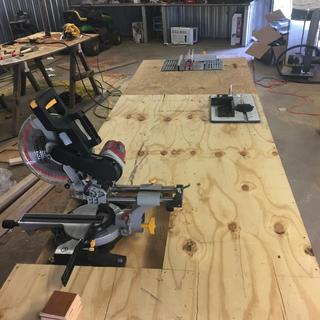 Work shop table,, it has the router top mounted in it with my compound mitersaw and table saw