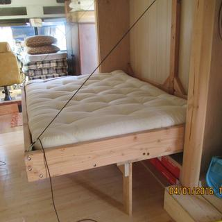 murphy style bed folded down/supported by sofa - the hinges helped it come together - now the winch.