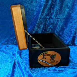 Side view of a custom made music box with Winnie the Pooh theme. Rockler decorative chain