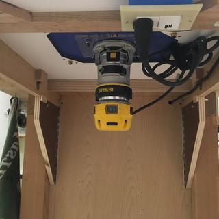 Permanently mounted the DeWalt router base & simply move the motor between two bases.