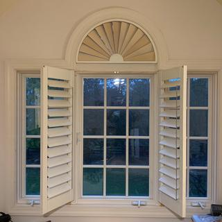 Semicircular transom and standard shutters for casement window. I have to hang the other 2 shutters.