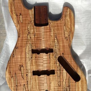 After 2 coats of Vinyl Sealer for Stringed Instruments, then 6 coats of Stringed Instrument Lacquer.