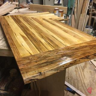 New kitchen counter top made of ambrosia maple with with the first coat of waterlox satin finish.