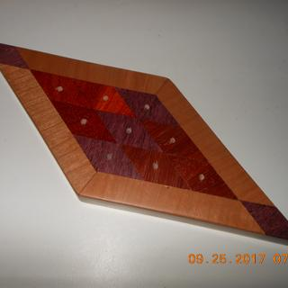 Padauk, Bloodwood, Purple Heart, and Cherry glued with Titebond  3 with no clamps.