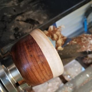 Rosewood with pine or maple on top (or something that was lying around)