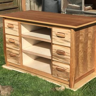 Cherry plywood top and sides. Ambrosia maple drawer fronts.