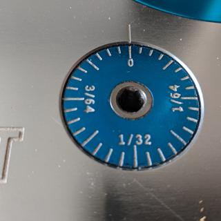 "Fine Adjustment Dial, marked as 4/64"" for one full turn.  Actual travel is twice that."