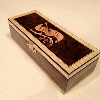 """Kazoo box"" using walnut burl, figured maple, died black veneer and brass."