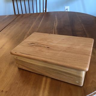 A cherry jewelry box with corner dowel accents.