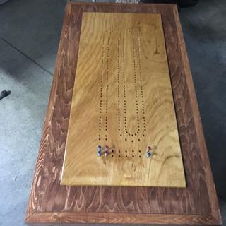 Bpoard is attached to a coffee table that was built just for the board.