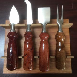 "An exotic set of 4 burl eucalyptus pieces that turned & finished well. ""Manly"" handles look great"