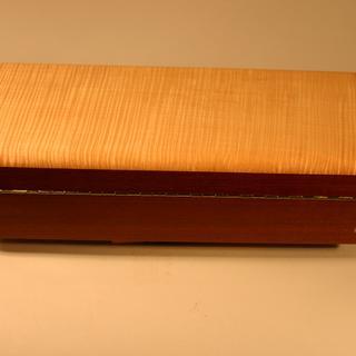 Cut and mortised hinge in longer box