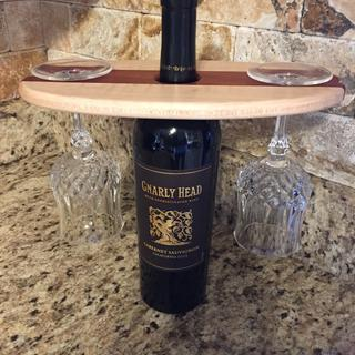 The maple was an excellent accompaniment to the Padauk I used to make this wine glass holder.