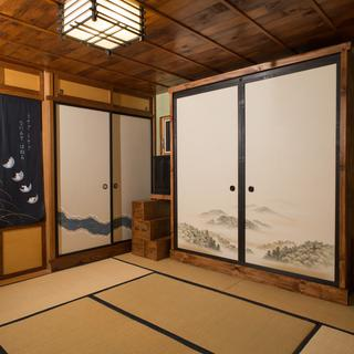 Bed closed, showing the cabinet design. The bed supports are the miniature step tansu on the left.
