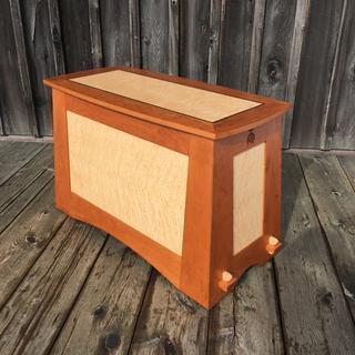Custom designed blanket chest in birds-eye maple and cherry. 4.5 degree tapered sides.