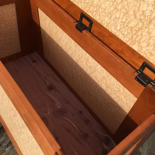 Unfinished aromatic cedar veneer on the inside of the bottom.