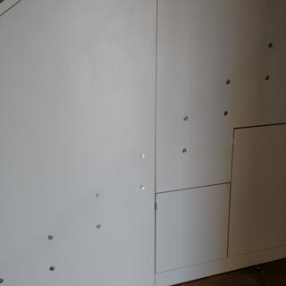 Hidden cabinets in stair panels.