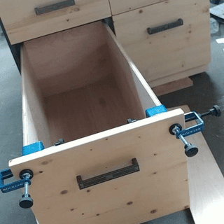 File cabinet drawer clamped together during install.