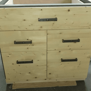 Drawer faces installed, all closed.