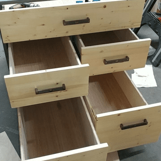 All drawer faces installed, pulled partially out.