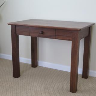 Walnut writing desk made by Bob Hoyt.