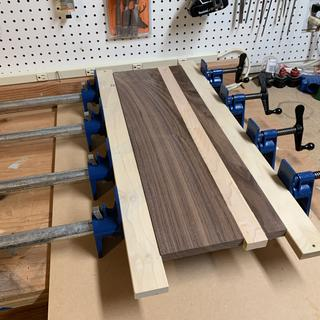 Flying up panels for a synthesizer cabinet