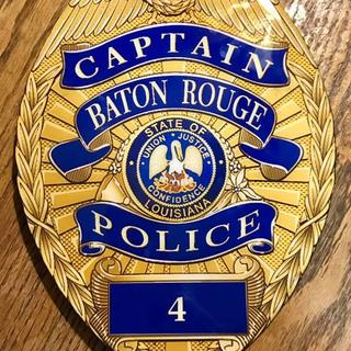 "This is a ""Captain's Badge"" plaque that I made (I brand the rear of them)."
