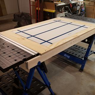 I combined two Kreg mobile project centers with a Rockler T-track table top to make a 7' long table.