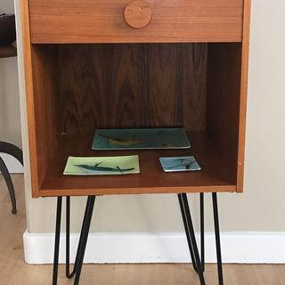 Mid century teak side table enhanced with pin legs to be more useable.