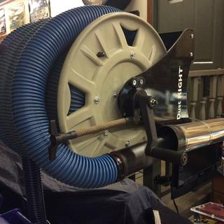 Mounted reel on a hd articulating arm and extended the brake screw out.