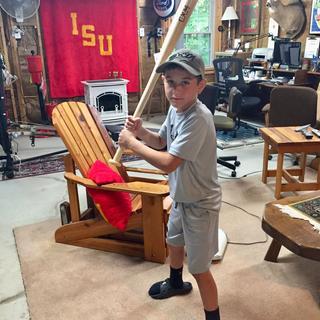 My Grandson and his custom made bat.