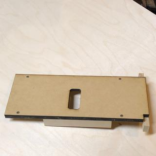 Simple shop made jig for placing and mortising the catch into place.