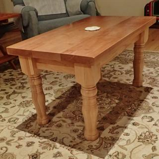 Coffee table with oak legs.