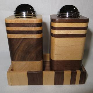 Maple & Walnut.  Maple (light colored wood) is Salt and Walnut (dark colored wood is Pepper).