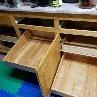 Here you can see how I installed the pull out draws with the slides attached to the inside shelf.