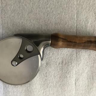 Handle is made out of curly koa